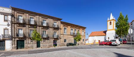 v shape: Historical houses and Sao Joao church in Dom Pedro V Square, Castelo de Vide. Stock Photo