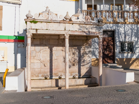 alter: Fontinha, the 16th century renaissance fountain in Republica Square of Alter do Chao. Portugal. Stock Photo