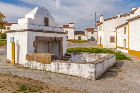 flor: The Fonte Branca (White Fountain), a 15th century fountain in Flor da Rosa near the Monastery. Crato, Alto Alentejo, Portugal.