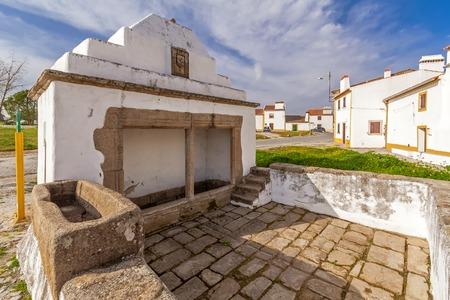 historical monument: The Fonte Branca (White Fountain), a 15th century fountain in Flor da Rosa near the Monastery. Crato, Alto Alentejo, Portugal.