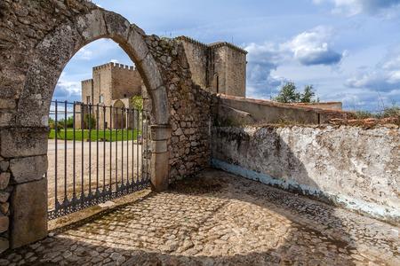 flor: Flor da Rosa Monastery in Crato seen through the gothic gate. Belonged to the Hospitaller Knights (aka Malta Order), a Crusader Order. Currently a Pousada de Portugal  Historical Inn of Portugal. Stock Photo