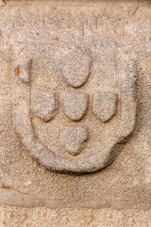 blazon: Castelo de Vide, Portugal - August 29, 2015: The Quinas - the Portuguese Blazon (Coat of Arms). Detail of the Medieval Borough of Castelo de Vide, Alto Alentejo, Portugal.