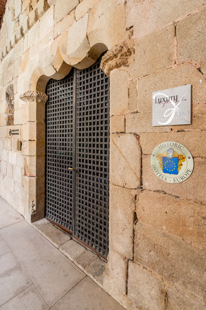 flor: Crato, Portugal. April 4, 2015: Entrance of the Pousadas de Portugal Historical Hotel in the medieval Flor da Rosa Monastery. Belongs to the Historical Hotels of Europe organization.