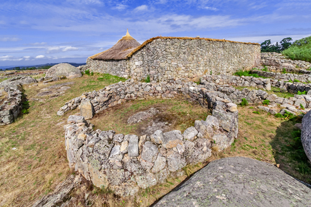 reconstructed: Roundhouse ruins and the reconstructed family nucleus building in Citania de Sanfins. A Castro Village (fortified Celtic-Iberian pre-historic settlement) in Pacos de Ferreira, Portugal.