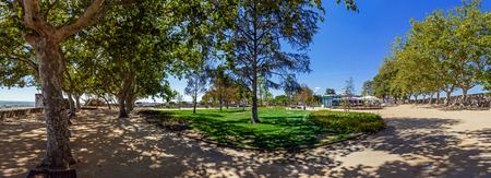 ribatejo: Trees casting fresh shade on the ground during summer in the Portas do Sol Garden and Belvedere in Santarem, Portugal.