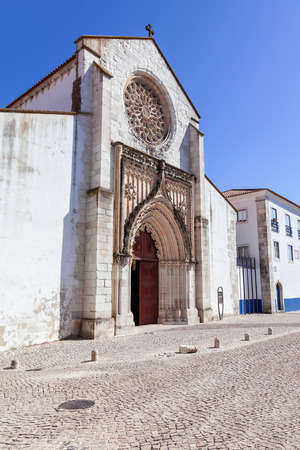 15th century: Santo Agostinho da Graca church, showing the largest Rose Window carved of a single slab of stone in Portugal. 14th and 15th century Mendicant and Flamboyant Gothic Architecture. Santarem, Portugal.