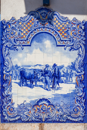 ribatejo: Typical Portuguese Azulejos (Blue tiles) depicting typical regional scenes, in the facade of the 19th century Municipal Market of Santarem, Portugal. Stock Photo