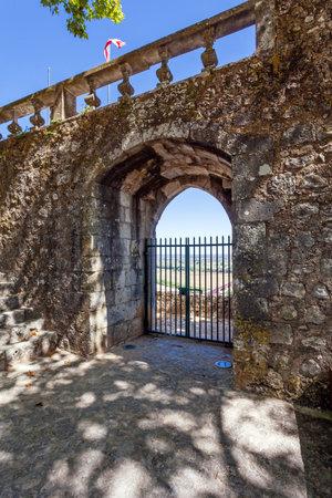 ribatejo: Porta do Sol Gate built into the medieval castle wall in Portas do Sol Garden. Santarem, Portugal.