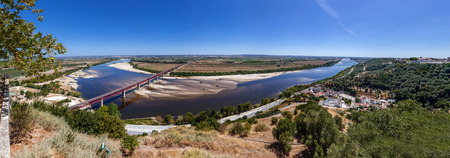 ribatejo: Santarem, Portugal. The typical Leziria alluvial plane landscape from the Ribatejo region with the Dom Luis I Bridge crossing the Tagus River, the seen from Portas do Sol belvedere.