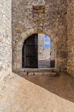 open gate: Open gate of the Sesimbra castle, Portugal.