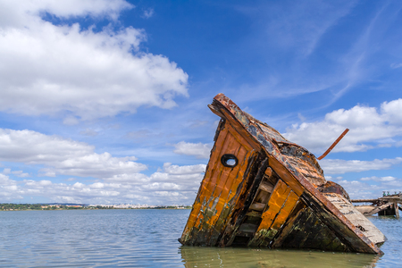 Sunken wooden ship in Seixal Bay (Tagus River),near Lisbon. Portugal.