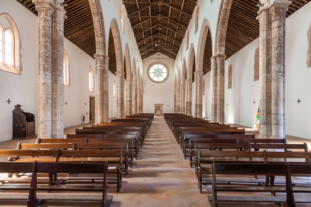 pews: Santarem, Portugal. September 12, 2015: The aisle and Naves of the Santa Clara Church. 13th century Mendicant Gothic Architecture. Santarem is called the Capital of Gothic in Portugal.