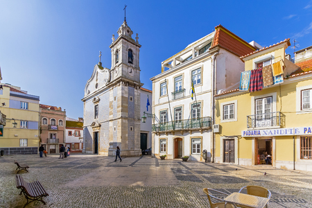 cityhall: Seixal, Portugal. January 30, 2015: Seixal City Hall square, with the City Hall in centre and the Seixal baroque church on the left.