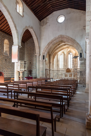 pews: Santarem, Portugal. September 11, 2015: The nave, aisle and altar of the medieval church of Santa Cruz. 13th century Gothic Architecture. Santarem, Portugal.