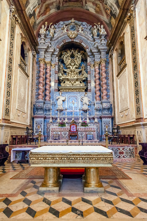 senhora: Santarem, Portugal. September 10, 2015: The baroque high altar in blue and gold colors inside the Santarem See Cathedral aka Nossa Senhora da Conceicao Church. 17th century Mannerist style.