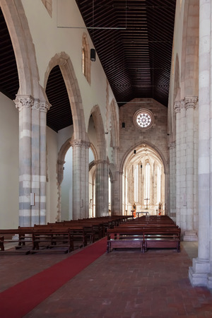 nave: Santarem, Portugal. September 11, 2015: Nave, altar and apse of the Santo Agostinho da Graca church. 14th and 15th century Mendicant and Flamboyant Gothic Architecture.
