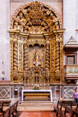 17th century: Santarem, Portugal. September 10, 2015: Baroque gilded chapel dedicated to Our Lady in the interior of the Santarem See Cathedral aka Nossa Senhora da Conceicao Church. 17th century Mannerist style.