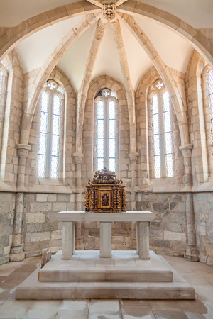 13th century: Santarem, Portugal. September 11, 2015: The aisle, altar and a gilded baroque tabernacle in the medieval church of Santa Cruz. 13th century Gothic Architecture. Santarem, Portugal.