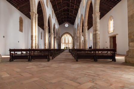 pews: Santarem, Portugal. September 11, 2015: The aisle and Naves of the Santa Clara Church. 13th century Mendicant Gothic Architecture. Santarem is called the Capital of Gothic in Portugal. Editorial