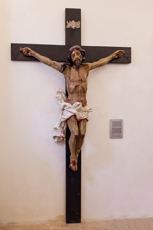 crucifix: Santarem, Portugal. September 9, 2015: 18th century Baroque Crucifix in natural size in the museum of the Misericordia Church.