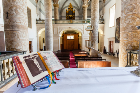 bible altar: Santarem, Portugal. September 11, 2015: Open Bible over the altar in Misericordia church. 16th century Hall-Church in late Renaissance Architecture.