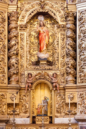 17th century: Santarem, Portugal. September 10, 2015: Baroque gilded chapel with a Jesus Christ image inside the Santarem See Cathedral aka Nossa Senhora da Conceicao Church. 17th century Mannerist style.