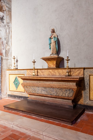 17th: Santarem, Portugal. September 10, 2015: Chapel with an image of Our Lady or Virgin Mary on a marble altar. Hospital de Jesus Cristo Church. 17th century Portuguese Mannerist architecture, called Chao. Editorial
