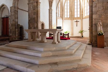 mendicant: Santarem, Portugal. September 11, 2015: Altar and Apse of the Santa Clara Church. 13th century Mendicant Gothic Architecture.