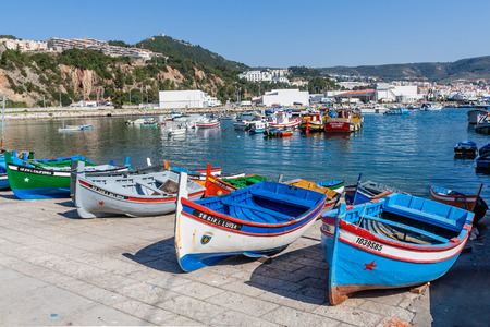 Sesimbra, Portugal. February 22, 2015: Traditional fishing boats (called Aiolas) at the fishing harbour of Sesimbra. Editorial