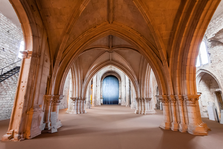mendicant: Santarem, Portugal. September 11, 2015: View under the High-Choir porch in the Church of the Sao Francisco Convent. 13th century Mendicant Gothic Architecture. Franciscan Religious Order. Editorial