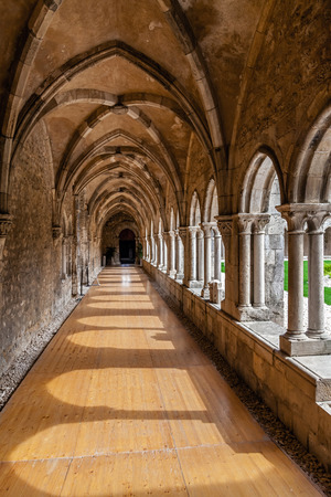 mendicant: Santarem, Portugal. September 10, 2015: Cloister corridors of the Sao Francisco Convent. 13th century Mendicant Gothic Architecture. Franciscan Religious Order.