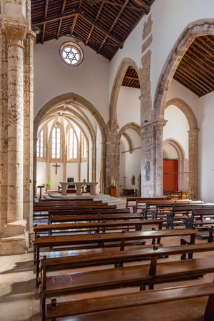 mendicant: Santarem, Portugal. September 12, 2015: The aisle and Naves of the Santa Clara Church. 13th century Mendicant Gothic Architecture. Santarem is called the Capital of Gothic in Portugal.