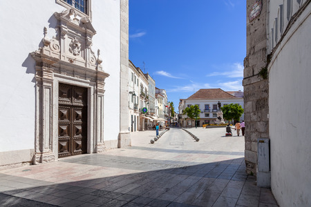 ribatejo: Santarem, Portugal. September 11, 2015: Portal of the Nossa Senhora da Piedade Church, with a view of the Sa da Bandeira Square. 17th century Mannerist church.
