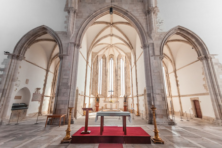 mendicant: Santarem, Portugal. September 11, 2015: Altar, apse and chapels of the Santo Agostinho da Graca church. 14th and 15th century Mendicant and Flamboyant Gothic Architecture.