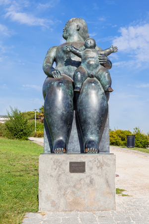 bought: Lisbon, Portugal - October 19, 2016: The Maternity, a statue by Fernando Botero. Bought by the city of Lisbon its placed in the Amalia Rodrigues Garden.
