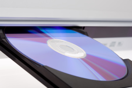 bluray: Close up of a DVD player ejecting disc Stock Photo