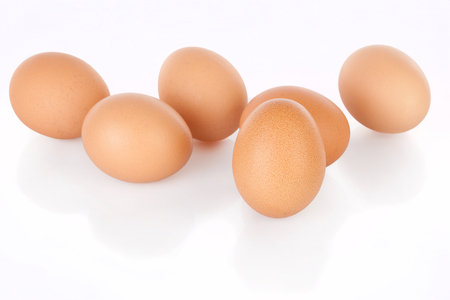 outs: Half dozen  brown chicken eggs isolated on white background Stock Photo