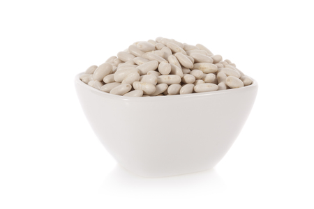 leguminous: Haricot or Cannellini beans in a bowl isolated on white background
