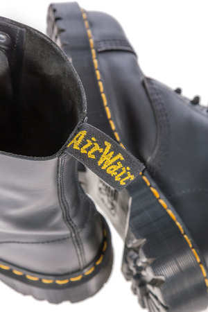 work boots: Lisbon, Portugal - March 16, 2010: Air Wair tag on a Dr. Martens black leather work boots with steel toe and military style.