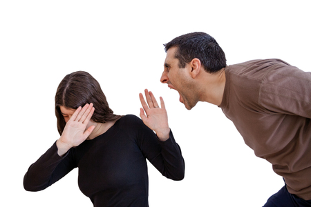 abusing: Domestic violence scene with a abusing husband or boyfriend shouting and yelling at his wife or girlfriend Stock Photo