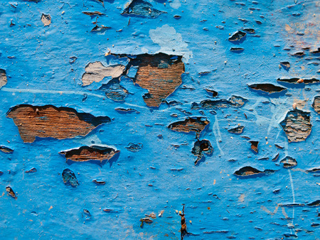 Peeling paint on wood boards from a boat hull background texture