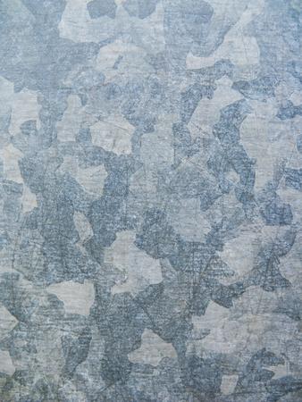 galvanize: Galvanized plated metal surface background. Urban camouflage effect.