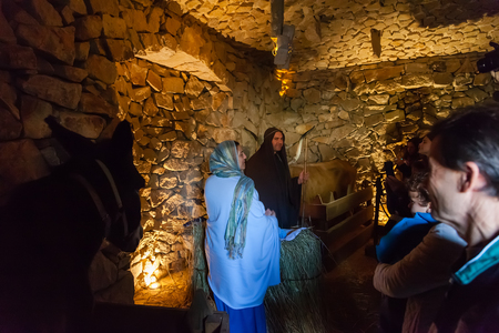 Priscos, Portugal - December 29, 2016: Largest living or live Nativity Scene in Europe. Holy Family, baby Jesus Christ, Mary, Joseph in stable, barn or manger. Organized and performed by locals