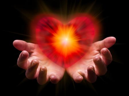 手は、明るく輝く、輝く光で、バレンタインやバレンタインデーのためのロマンチックな赤いハートをカップリングし、保持または示しています。 写真素材