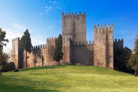 Castelo de Guimaraes Castle. Most famous castle in Portugal. Birth place of the first Portuguese King and the Portuguese nation. Guimaraes, Portugal. Editorial