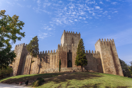 Castelo de Guimaraes Castle. Most famous castle in Portugal. Birth place of the first Portuguese King and the Portuguese nation. Guimaraes, Portugal. Editorial