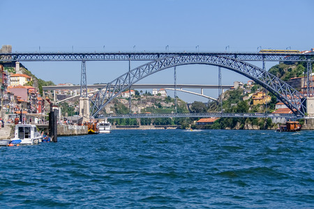 19th century Dom Luis I bridge over Douro River with Porto city (L) and Gaia (R). Infante D. Henrique Bridge in background. Porto, Oporto, Portugal