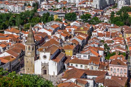 Tomar, Portugal. The city of Tomar with Igreja de Sao Joao Baptista Church and Republica Square. Seen from the Castle of Tomar and Convento de Cristo
