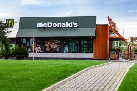 Coina, Portugal - October 23, 2019: Storefront of the McDonalds restaurant and McCafe with the green and brown tones