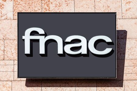 Almada, Portugal - October 24, 2019: Signboard advertising the Fnac, a books, electronics and technology store in a shopping center or shopping mall exterior wall. Editoriali